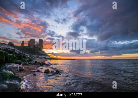 Reculver Towers in Herne Bey Thanet with the sun setting - Stock Photo
