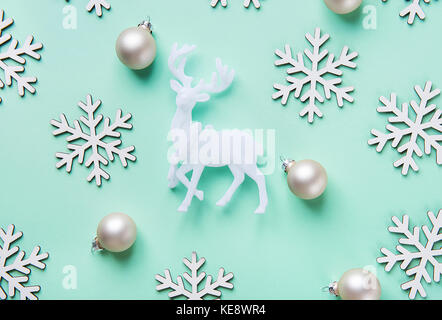 Elegant Christmas New Year Greeting Card Poster White Reindeer Snow Flakes Balls Pattern on Turquoise Blue Background. - Stock Photo
