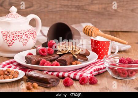 Chocolate rolls with hazelnuts and raspberries. - Stock Photo