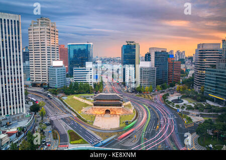 Seoul. Image of Seoul downtown with Sungnyemun Gate during sunset. - Stock Photo