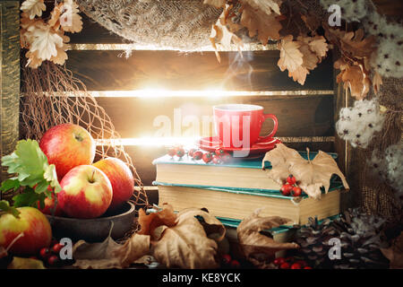 Autumn still life with a cup of coffee, apples and autumn leaves. Autumn background. - Stock Photo