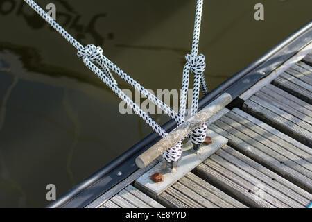 Mooring ropes on pontoon cleat - Stock Photo