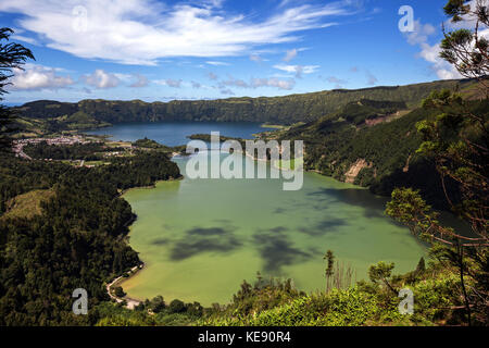 View of the volcanic crater Caldera Sete Cidades with the crater lakes Lagoa Verde and Lago Azul - Stock Photo