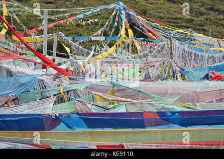 The prayer flags around the mountain behind Serti Gompa Monastery, in Langmusi - Amdo Tibet. Right next to it is - Stock Photo