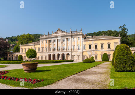 Como, Italy - May 27, 2016: View of Villa Olmo in the lakefront of Como City, Italy. Flower beds in the foreground. - Stock Photo