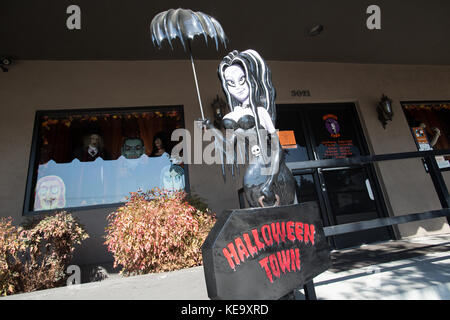 Halloween props and costumes in a shop window display Stock Photo ...