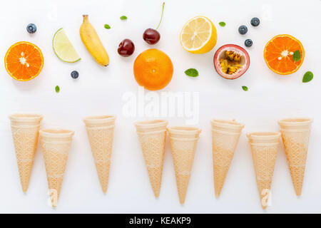 Flat lay various fresh fruits blueberry ,strawberry ,orange ,banana ,passion fruit ,apple and cherry setup on white - Stock Photo