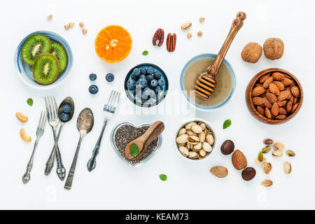 Ingredients for a healthy foods background, nuts, honey, berries, fruits, blueberry, orange, almonds, walnuts and - Stock Photo