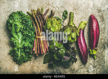 Flat-lay of fresh green and purple vegetables, top view - Stock Photo
