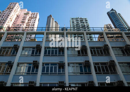 Low angle view on apartement buildings in Hong Kong, Asia - Stock Photo