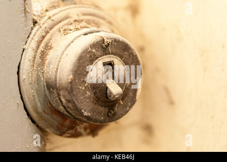 Old enectric switch in abandoned home - Stock Photo