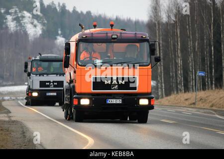 SALO, FINLAND - MARCH 24, 2016: Two MAN Schorling Road Sweeper trucks drive along highway in Salo. Modern street - Stock Photo