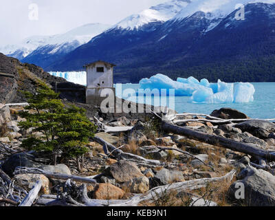 Concrete abandoned building on shore of Lago Argentino, Perito Moreno Glacier, Argentina - Stock Photo