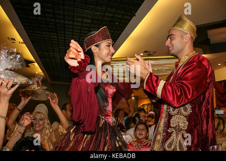 The bride and groom to be, at a Jewish Moroccan, henna ceremony The Hina, also Henna, ceremony proceeds the wedding - Stock Photo