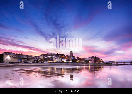 Cromer In Pink - Panoramic view of British seaside town of Comer. Fantastic sunset colours of pinks and purples - Stock Photo