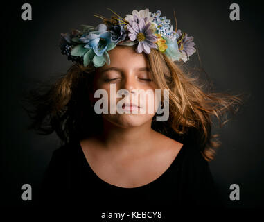 Cute little girl with flower wreath - Stock Photo