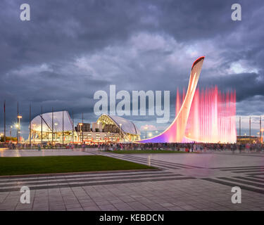 SOCHI, RUSSIA - JUNE 20, 2017: Music Fountain and Olympic Stadium Fisht in the Evening, Sochi, Russia. Named after - Stock Photo