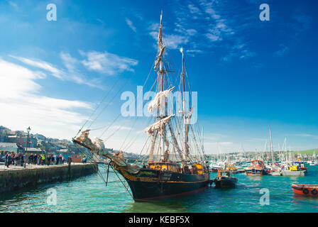 The Tres Hombres is a 32 Meter Schooner which transports fairtrade goods by windpower only. - Stock Photo