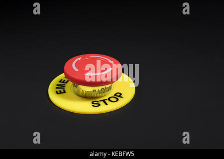 Big red button on dark background - metaphor for 'Finger on the Button', possible finger on nuclear button, & concept - Stock Photo