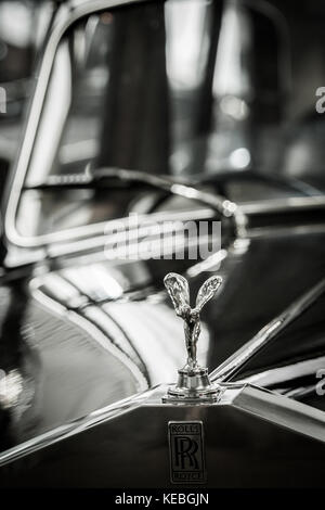 Black and white image of the Spirit of Ecstasy the iconic Flying Lady or Silver Lady on the bonnet of a Rolls Royce - Stock Photo