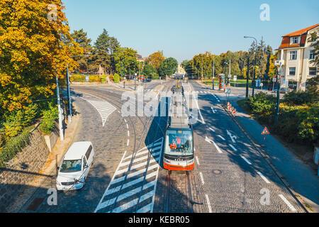 Prague, Czech Republic, September 29, 2017: Red tram goes on old town in Prague. Prague's major public transport operator is The Capital City of Pragu