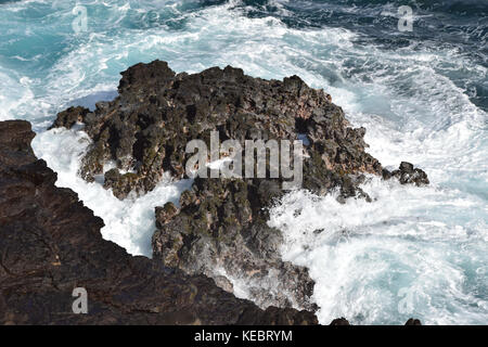 Waves crashing near the Halona Blowhole in the Southeast corner of Oahu, Hawaii - Stock Photo