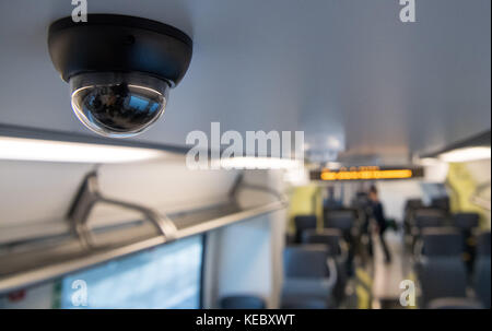 A security camera is installed onboard a train designed according to the new umbrella brand for the local railway - Stock Photo