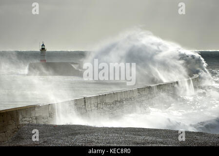 Newhaven, East Sussex. 20th October 2017: Strong winds along the South coast overnight cause huge waves to crash - Stock Photo