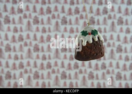 red white Christmas photography picture of hanging up Christmas decoration of xmas pudding food cream holly with - Stock Photo