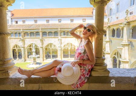 Tourist woman in Coimbra - Stock Photo