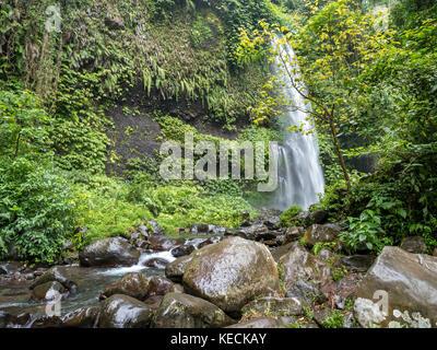 Sendang Gile Waterfall in the near of the Volcano Rinjani, Lombok, Indonesia - Stock Photo