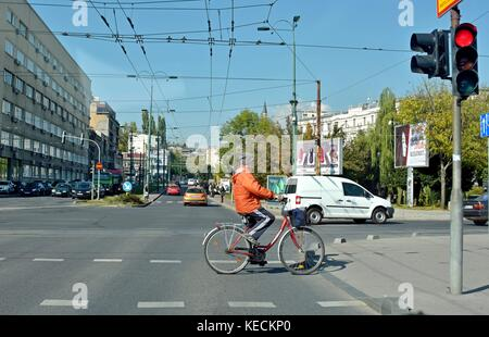 People crossing street on traffic light - Stock Photo