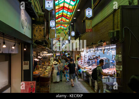 Kyoto, Japan -  May 22, 2017:  Shopping at the Nishiki market, Kyoto, for fish and fermented vegetables - Stock Photo