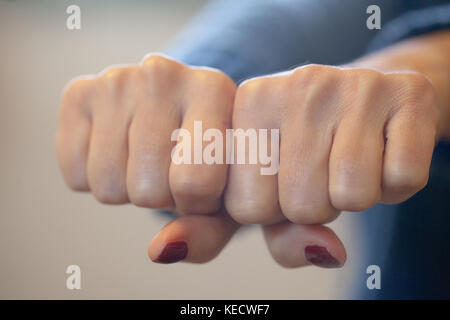 woman give a double punch, protecting herself. boxe fist. concept of defence, security, strength and rebellion - Stock Photo