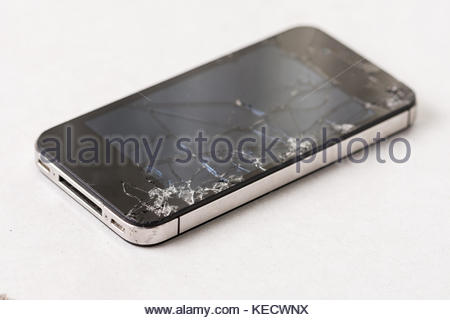 Cracked smashed lcd display touch screen on the smartphone . - Stock Photo