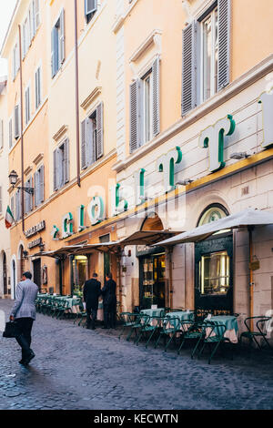 Business people walk to work and pause to meet at the famous Giolitti gelateria and cafe in the early morning hours in Rome, Italy, near the Pantheon