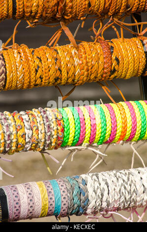 Large Group of bright wristbands on display - Stock Photo
