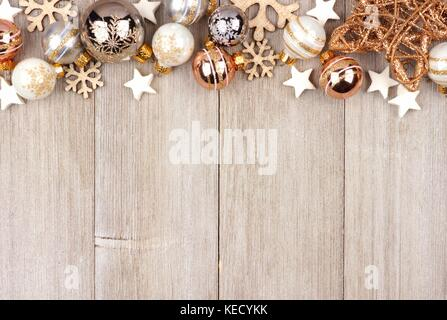 Christmas Top Border With White And Gold Ornaments On A Rustic Wood Background