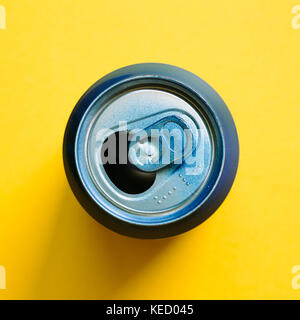 Empty can on yellow background - Stock Photo