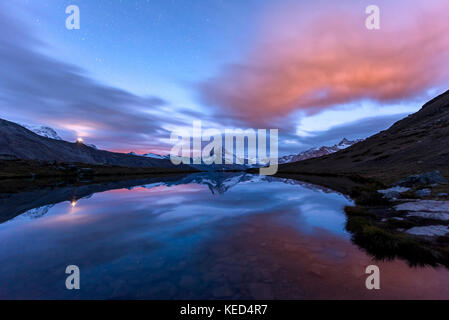 Night view, starry sky, snow-covered Matterhorn reflected in the Sellisee, Valais, Switzerland - Stock Photo