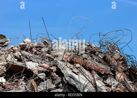 Pile of rubble from a dismantled building at a demolition site. - Stock Photo