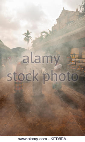 Buddhist Pilgrims lighting incense sticks outside the Sri Maha Bodhi. The sacred bodhi tree. Anuradhapura, North - Stock Photo