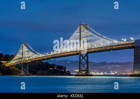Night view of the the western section of the San Francisco-Oakland Bay Bridge, San Francisco, California, USA - Stock Photo