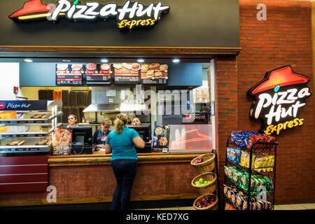 Miami Florida MIA Miami International Airport concession Pizza Hut Express restaurant pizzeria fast food counter - Stock Photo