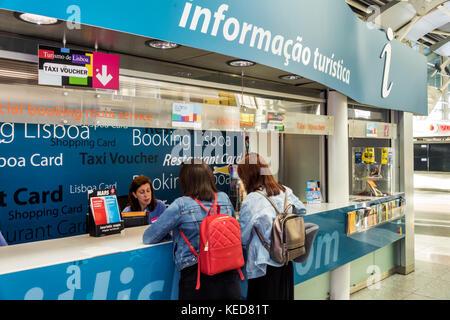 Lisbon Portugal Humberto Delgado Airport LIS Portela Airport terminal tourist information counter desk woman agent - Stock Photo