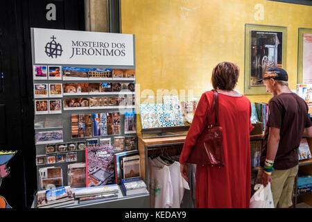 Lisbon Portugal Belem Mosteiro dos Jeronimos Jeronimos Monastery gift shop shopping souvenir man woman inside display - Stock Photo