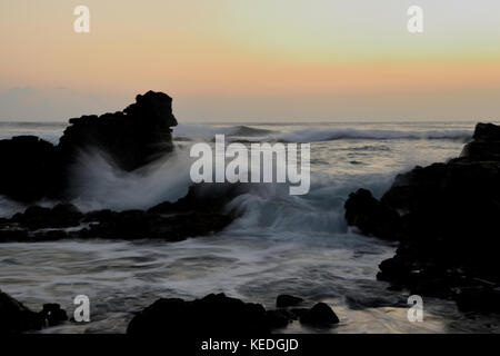 Sunrise photoshoot at Erma's Beach on the island of Oahu, Hawaii - Stock Photo
