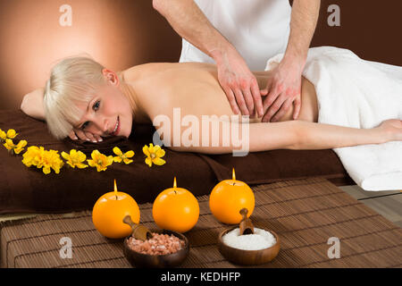 Portrait Of A Young Woman Getting Massage In A Beauty Spa - Stock Photo