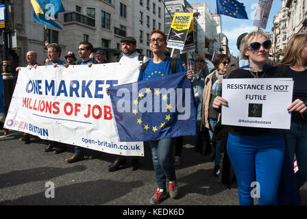 Demonstrators against Brexit march with large banners 'One Market/ Millions of jobs', European flag and poster 'Resistance - Stock Photo
