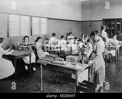 Women Sewing and Knitting in Work Room,American Red Cross Garment Division,Washington DC,USA,Harris & Ewing,1917 - Stock Photo